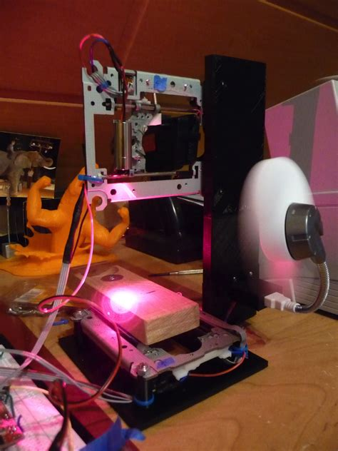 16-Year-Old Creates a Working Laser Engraver From 2 DVD