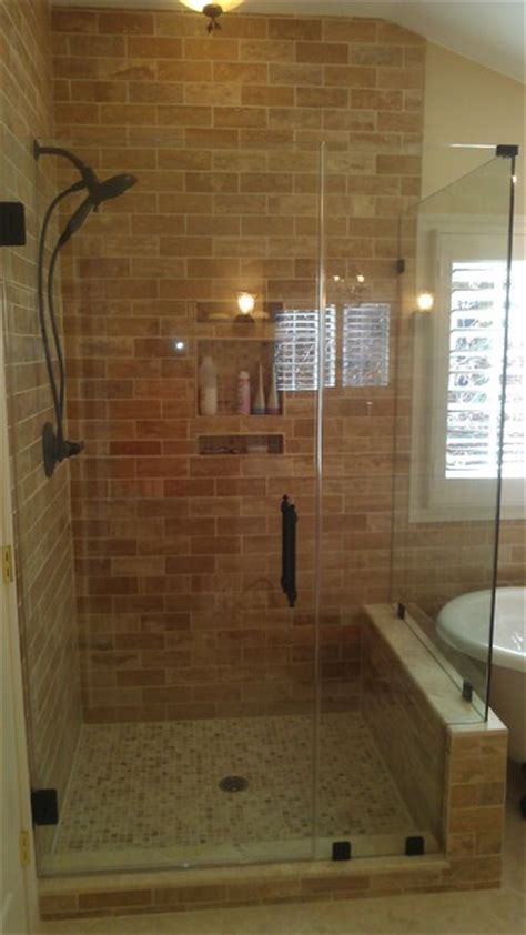 Frameless Shower Door with Earth Tones and Oil Rubbed